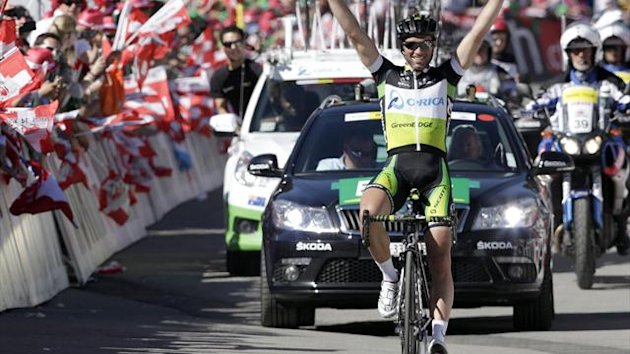 Orica Green Edge rider Michael Albasini of Switzerland celebrates winning the eighth stage of the Tour de Suisse cycling race in Arosa