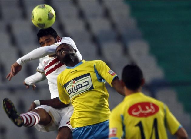 Salah Soliman of El Zamalek fights for the ball with John Antwi of El Ismaily during their opening Egyptian Premier League derby soccer match at Cairo Stadium