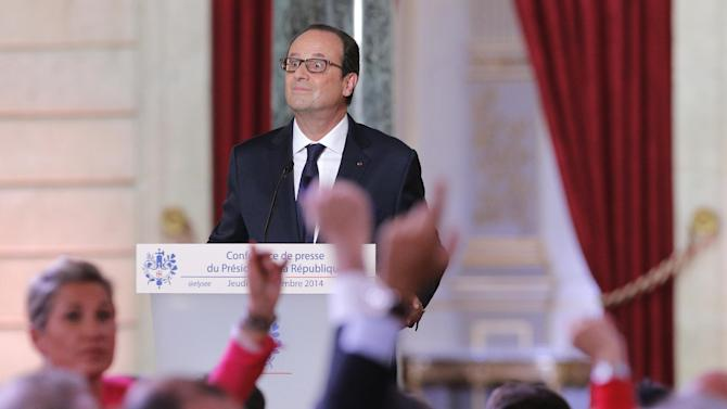 French President Francois Hollande waits for questions during a press conference at the Elysee Palace, Thursday, Sept.18, 2014. Hollande said he agreed to Iraq's request for air support at a meeting of his top defense and security advisers earlier Thursday. (AP Photo/Christophe Ena)