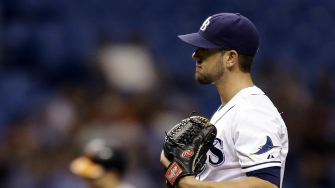 Tampa Bay Rays starting pitcher James Shields reacts as Baltimore Orioles' Chris Davis rounds the bases after hitting a fourth-inning home run during a baseball game, Tuesday, Oct. 2, 2012, in St. Petersburg, Fla. (AP Photo/Chris O'Meara)