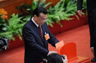 Li Keqiang casts his vote for the election for the new president of China during the 12th National People&#39;s Congress in the Great Hall of the People in Beijing, on March 14, 2013. China&#39;s parliament named Li to the post of premier on Friday, a role that involves running day-to-day government in the world&#39;s second-largest economy