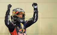 Winner Red Bull Renault driver Sebastian Vettel of Germany stands on his race car as he celebrates winning Formula One's Singapore Grand Prix