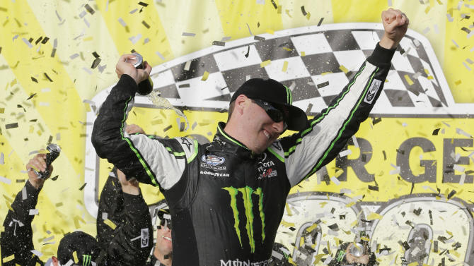Kyle Busch celebrates in Victory Lane after winning the NASCAR Nationwide Series auto race at Chicagoland Speedway in Joliet, Ill., Saturday, Sept. 14, 2013. (AP Photo/Nam Y. Huh)