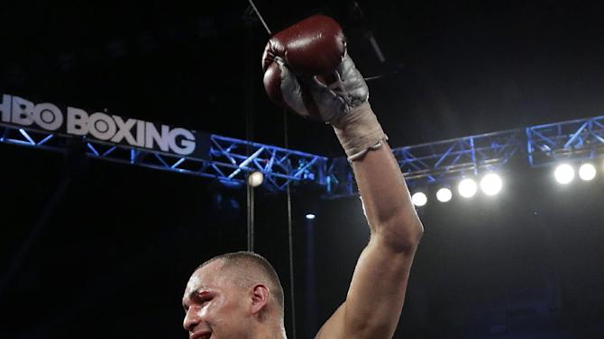Mike Alvarado reacts after a WBO super lightweight title fight against Brandon Rios, Saturday, March 30, 2013, in Las Vegas. Alvarado won by unanimous decision. (AP Photo/Julie Jacobson)