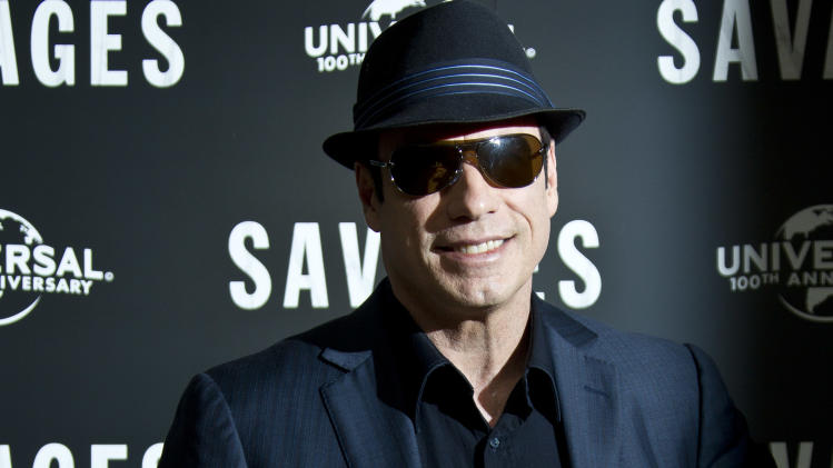 US actor John Travolta poses for photographs, during the photo call for  'Savages', at a central London hotel, Wednesday, Sept. 19, 2012. (AP Photo/Joel Ryan)