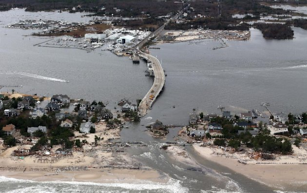This aerial photo made from a helicopter shows storm damage from Sandy over the Atlantic Coast in Mantoloking, N.J., Wednesday, Oct. 31, 2012. The photo was made from a helicopter behind the helicopte