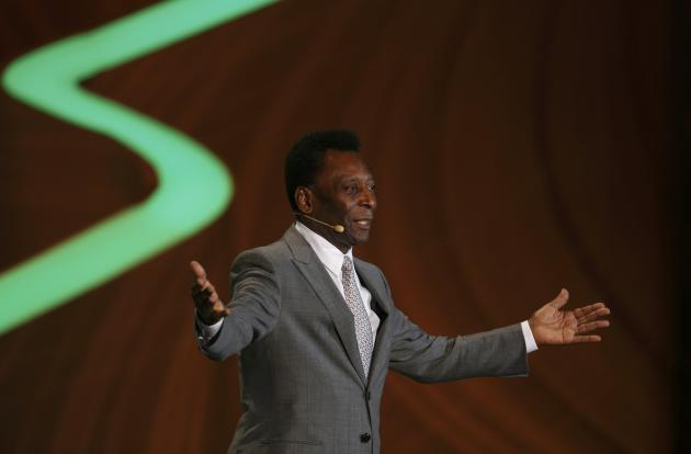 Pele addresses the audience during the draw for the 2014 World Cup in Sao Joao da Mata