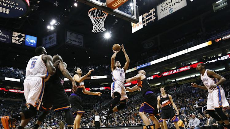 Oklahoma City Thunder's Thabo Sefolosha (2), of Switzerland, shoots as he gets past Phoenix Suns' Luis Scola, third from left, of Argentina, and Marcin Gortat, third from right, of Poland, while Thunder's Kendrick Perkins (5) and Kevin Durant (35) watch along with Suns' Goran Dragic (1), of Slovenia, during the first half in an NBA basketball game, Sunday, Feb. 10, 2013, in Phoenix. (AP Photo/Ross D. Franklin)