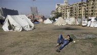 A protester who opposes Egyptian President Mohamed Mursi sleeps outside his tent at Tahrir Square in Cairo February 26, 2013. REUTERS/Amr Abdallah Dalsh