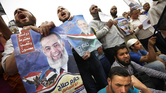 Followers of Egyptian Muslim cleric and a former candidate for the Egyptian presidency Hazem Abu Ismail protest the disqualification of their leader outside the Presidential Election Committee in Cairo, Egypt, Wednesday , April. 18, 2012. (AP Photo/Fredrik Persson)?
