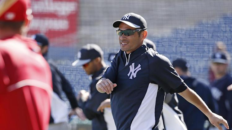 New York Yankees' Ichiro Suzuki does agility exercises with teammates while warming up before a spring exhibition baseball game in Clearwater, Fla., Thursday, March 13, 2014. (AP Photo/Kathy Willens)