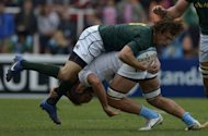 South Africa's fullbak Zane Kirchner (top) is tackled by Argentina's flanker Alvaro Galindo during the Rugby Championship second round match at Malvinas Argentinas stadium in Mendoza, some 1050 km west of Buenos Aires