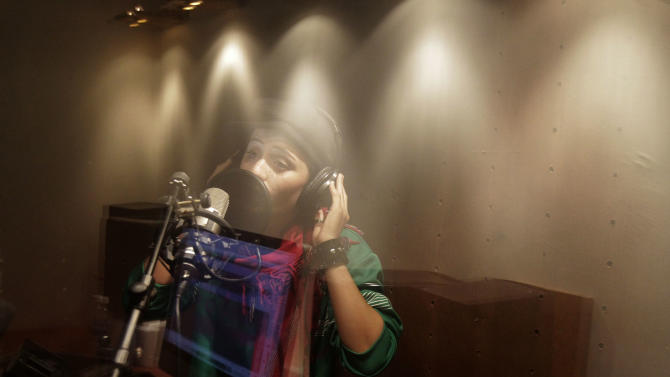 In this Wednesday, Oct. 3, 2012 photo, Afghanistan's first female rapper Sosan Firooz sings in a studio in Kabul, Afghanistan. Firooz, 23-year-old singer is making history in her homeland where society frowns on women who take the stage. (AP Photo/Ahmad Jamshid)