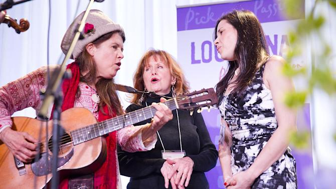"""From left, Victoria Williams joins Maggie Warwick and Shannon McNally for an impromptu performance of """"You Are My Sunshine,"""" at the Only in Louisiana pre-Grammy brunch on Saturday, Feb. 9, 2013 at the Dorothy Chandler Pavilion in Los Angeles. Williams is a singer / songwriter and Louisiana native; Warwick appeared on the famed Louisiana Hayride as Margaret Lewis; McNally is a singer and musician. (Photo by Colin Young-Wolff/Invision for LouisianaTravel.com/AP Images)"""