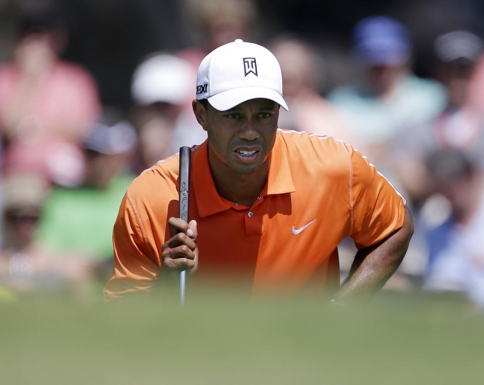 Tiger Woods lines up a putt on the second green during the first round of the Tour Championship golf tournament at East Lake Golf Club in Atlanta, Thursday, Sept. 19, 2013. (AP Photo/John Bazemore)