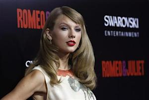 "Swift poses at the premiere of ""Romeo and Juliet"" in Los Angeles"