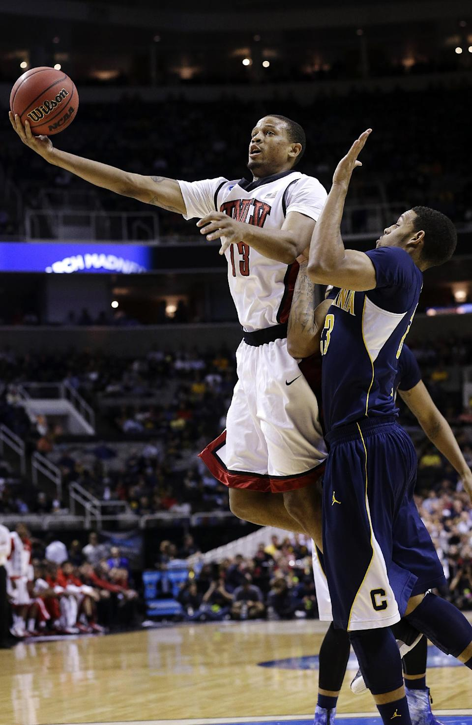 UNLV guard Bryce Dejean-Jones (13) shoots against California guard Allen Crabbe (23) during the first half of a second-round game in the NCAA college basketball tournament in San Jose, Calif., Thursday, March 21, 2013. (AP Photo/Jeff Chiu)