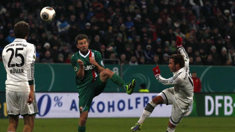 Bayern Munich's Goetze tries to score against Augsburg's Baier during their third round German soccer cup match in Augsburg