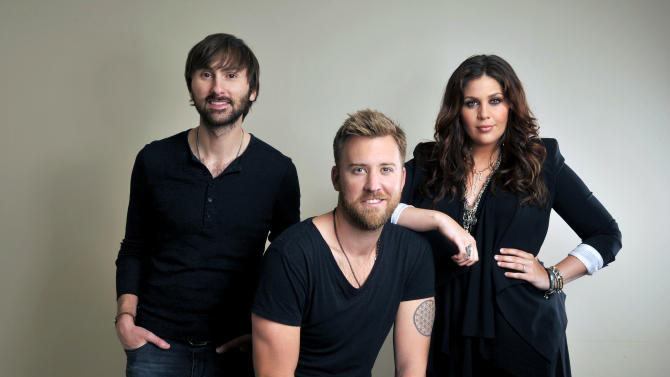 """FILE - This March 22, 2013 file photo shows members of Lady Antebellum, from left, Dave Haywood, Charles Kelley and Hillary Scott in Nashville, Tenn. The title for Lady Antebellum's forthcoming new album, """"747,"""" refers to a hook in the title song about how a commercial jetliner can't go fast enough for a man trying to reclaim his love. It's also a fitting analogy for the country trio's own super-sonic momentum over the last year. (Photo by Donn Jones/Invision/AP, File)"""