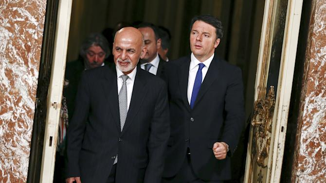 Afghanistan's President Ghani and Italian Prime Minister Renzi arrive to lead a news conference during a meeting at Chigi palace in Rome