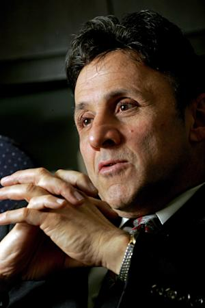 FILE - In this March 31, 2006 file photo, Columbine High School principal Frank DeAngelis talks about the massacre at the school in Littleton, Colo., years earlier. DeAngelis, who helped shepherd students to safety during the 1999 shootings there, is retiring after 18 years of leading the school. In a letter to parents Tuesday, Aug. 13, 2013, DeAngelis said he would step down at the end of the school year. (AP Photo/Jack Dempsey, File)
