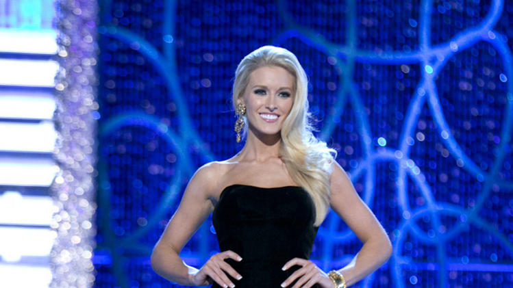 This photo courtesy Miss America Organization shows Miss DC, Allyn Rose, during the Evening Wear portion of preliminary competition at the 2013 Miss America Pageant in Las Vegas, Tuesday, Jan. 8, 2013.  Win or lose, Saturday's Miss America competition will be Rose's last pageant. The 24-year-old plans to undergo a double mastectomy after the event as a preventative measure to reduce her chances of developing the disease that killed her mother, grandmother and great aunt. (AP Photo/Courtesy Miss America Organization)