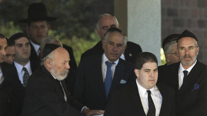 The flag-draped coffin of former U.S. Sen. Arlen Specter is taken from Har Zion Temple after his funeral, Tuesday, Oct. 16, 2012, in Penn Valley, Pa. Family members say Specter died Sunday of complications from non-Hodgkin lymphoma. He was 82. (AP Photo/Matt Rourke)