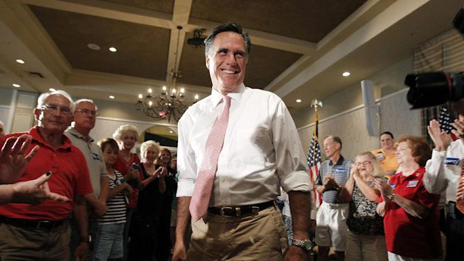 Republican presidential candidate former Massachusetts Gov. Mitt Romney smiles as he arrives for a town hall meeting Wednesday, Sept. 14, 2011, in Sun Lakes, Ariz. (AP Photo/Ross D. Franklin)