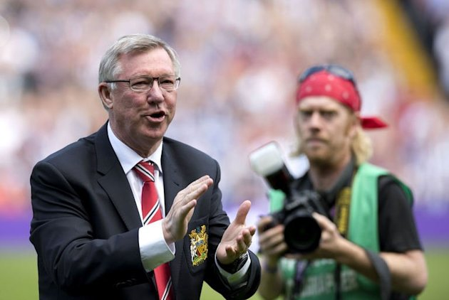 Alex Ferguson applauds the crowd at The Hawthorns in West Bromwich, on May 19, 2013