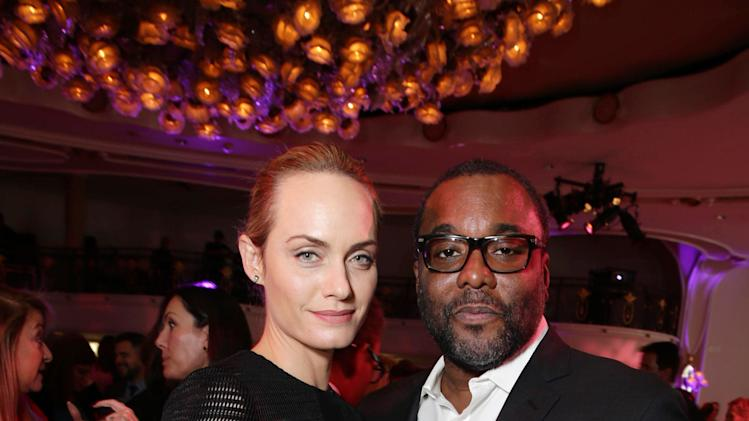 Taylor Schilling and Lee Daniels attends THR's celebration of power 100 women in entertainment breakfast on Wednesday, Dec. 11, 2013 in Beverly Hills, Calif. (Photo by Eric Charbonneau/Invision for The Hollywood Reporter/AP Images)