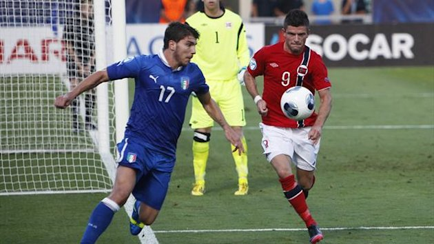 Italy's Alberto Paloschi (L) and Norway's Valon Berisha (R) fight for the ball during their European Under-21 Championship match at Bloomfield Stadium in Tel Aviv (Reuters)