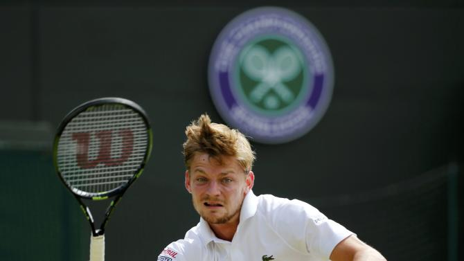 David Goffin of Belgium hits a shot during his match against Stan Wawrinka of Switzerland at the Wimbledon Tennis Championships in London