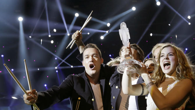 """Winner of the 2013 Eurovision Song Contest Emmelie de Forest of Denmark who sang """"Only Teardrops,"""" celebrates with the trophy after the final at the Malmo Arena in Malmo, Sweden, Saturday, May 18, 2013. The contest is run by European television broadcasters with the event being held in Sweden as they won the competition in 2012. (AP Photo/Alastair Grant)"""