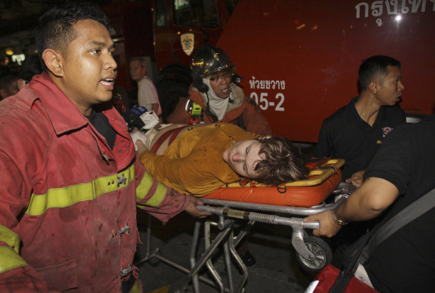 Thai firefighters move victim of a hotel fire to hospital in Bangkok on Thursday March 8, 2012. A fire has burned part of a high-rise hotel in Bangkok&#39;s main tourist district.(AP Photo/Sakchai Lalit)
