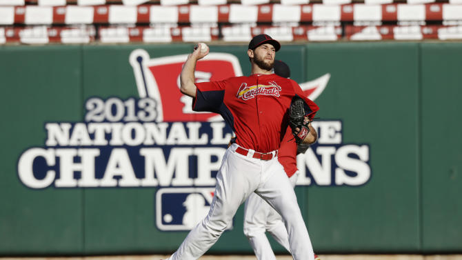 St. Louis Cardinals starting pitcher Michael Wacha warms up before Game 5 of baseball's World Series against the Boston Red Sox Monday, Oct. 28, 2013, in St. Louis. (AP Photo/Charlie Riedel)