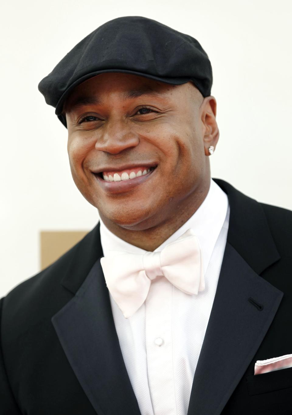 FILE - In this Sept. 18, 2011 file photo, LL Cool J arrives at the 63rd Primetime Emmy Awards in Los Angeles. Los Angeles police say the rapper grabbed and held a burglary suspect at his Studio City home Wednesday morning Aug. 22,2012. (AP Photo/Matt Sayles, File)