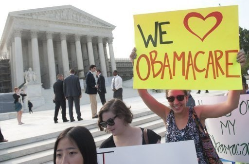 "Demonstrators in favor of US President Barack Obama's signature healthcare legislation await a decision by the US Supreme Court on the constitutionality of the Affordable Healthcare Act, outside the Supreme Court in Washington, DC, June 28. Obama claimed a ""victory"" for all Americans after the Supreme Court upheld his reforms to extend health insurance to another 32 million citizens."