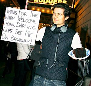 "Orlando Bloom Thanks Joan Rivers for ""Warm Welcome"" With Cute Sign, Cake"