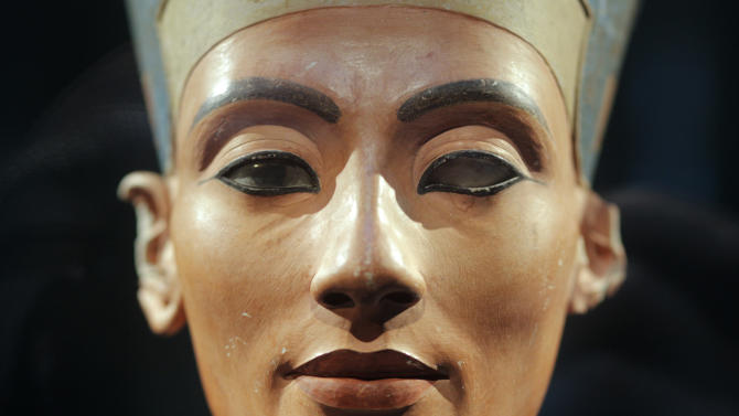 "FILE - In this Oct. 15, 2009 file photo the famous 3,300-year-old bust of  Queen Nefertiti  is on display  at the ""Neues Museum"", ( New Museum), in Berlin, Germany. Berlin is to honor the centenary of the discovery of a famed bust of Egypt's Queen Nefertiti - one of the city's top tourist attractions - with an exhibition of works from the Amarna site where she was found, many of them freshly restored. The Egyptian Museum said Monday Aug. 27, 2012  that the show, ""In the Light of Amarna,"" will open Dec. 6 - the 100th anniversary of the day when a German excavator unearthed the 3,300-year old limestone bust of Nefertiti, wife of Pharaoh Akhenaton, at Amarna in southern Egypt. (AP Photo/Markus Schreiber, file)"