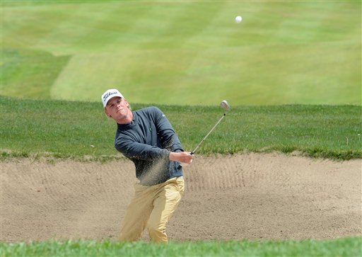 Morten Madsen, from Denmark, shoots from a sand trap during the last round of the Madeira Islands Open, Sunday May 19, 2013, at the Santo da Serra golf course, in Machico, Portugal. Madsen finished se