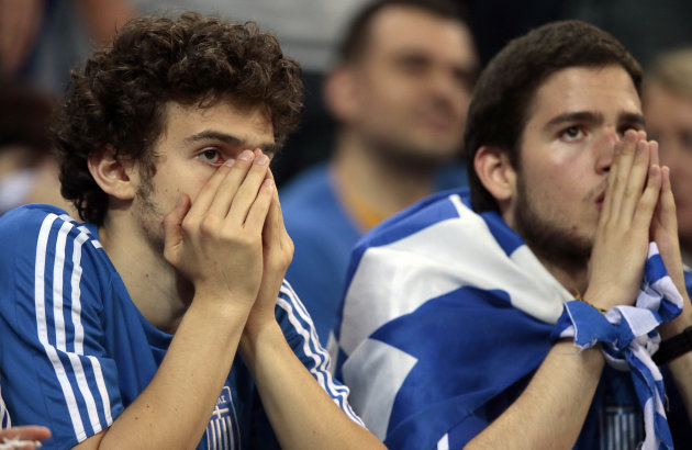 Greek fans watch the Euro 2012 soccer championship quarterfinal match between Germany and Greece in Gdansk, Poland, Friday, June 22, 2012. (AP Photo/Ivan Sekretarev)