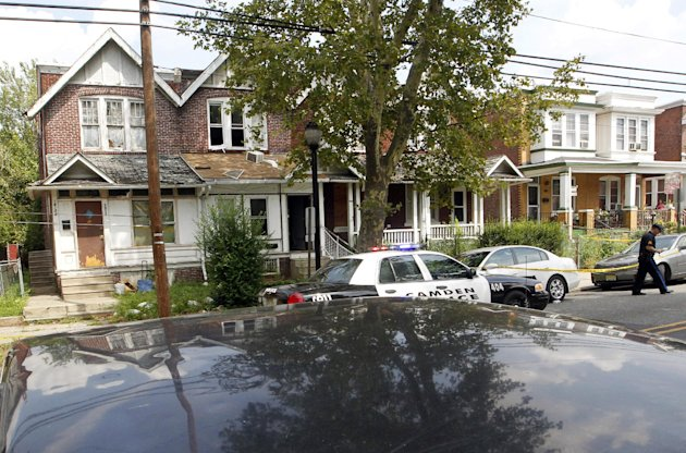 "An air conditioner rests on a porch roof, second from left, at 1415 Kaighn Ave., in Camden, N.J., Wednesday, August 22, 2012, after police in Camden say a 2-year-old boy was decapitated, apparently by his mother, and his head left in the freezer of their home before woman fatally stabbed herself. Chevonne Thomas, 33, called 911 just after midnight to say something had happened to her child and it ""sounded like she had done it,"" Camden County Prosecutor's Office spokesman Jason Laughlin said. Officers found Zahree Thomas' body on the first floor of the home on Kaighn Avenue and the boy's head in the freezer. (Photo/Mel Evans)"