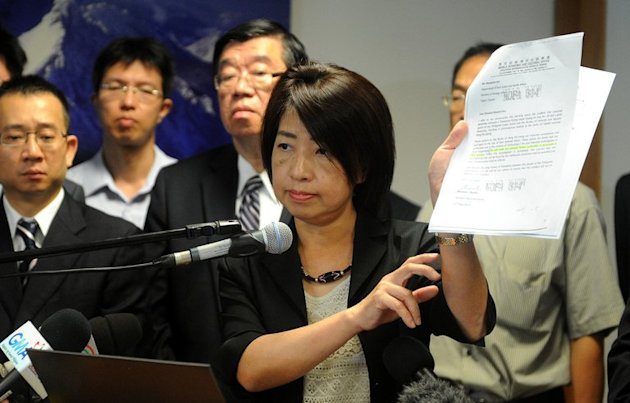 Chen Wen-chi (C), an official from Taiwan's Ministry of Justice pictured in Manila, on May 18, 2013