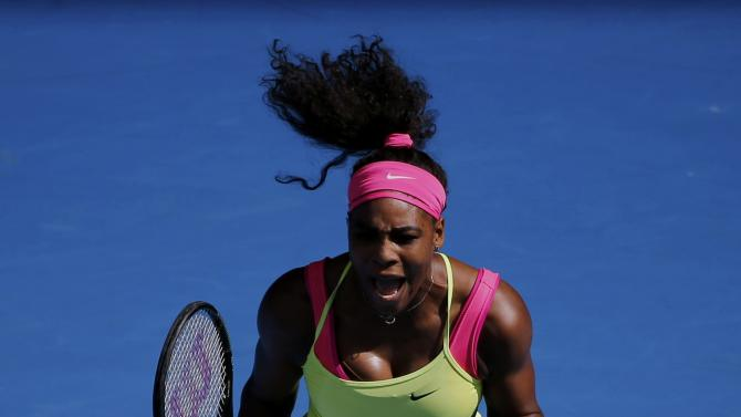Williams of the U.S. reacts after winning the first set against compatriot Keys during their women's singles semi-final match at the Australian Open 2015 tennis tournament in Melbourne