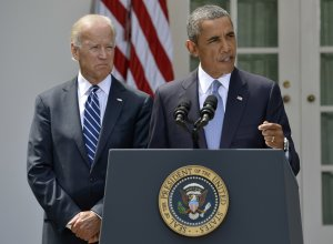 U.S. President Barack Obama speaks next to Vice President …