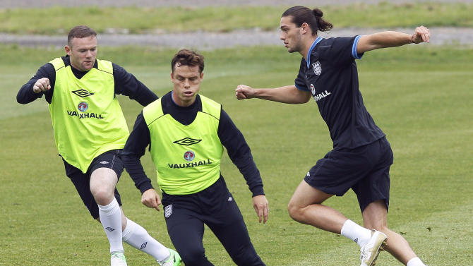 England's Andy Carroll, right, Scott Parker, center, and Wayne Rooney vie for the ball during a training session in Krakow, Poland, Friday, June 22, 2012. England will play Italy in a Euro 2012 quarterfinal soccer match on Sunday in Ukraine. (AP Photo/Kirsty Wigglesworth)