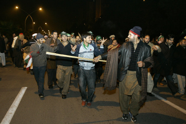 Supporters of Pakistani Sunni Muslim cleric Tahir-ul-Qadri, march towards high security area Red Zone at an anti government rally in Islamabad, Pakistan Tuesday, Jan. 15, 2013. Thousands of Pakistanis fed up with political leaders they say are corrupt and indifferent rallied in the Pakistani capital Tuesday, as the fiery cleric who organized the rally called for the government to resign and for his followers to remain on the streets until then. (AP Photo/Anjum Naveed)