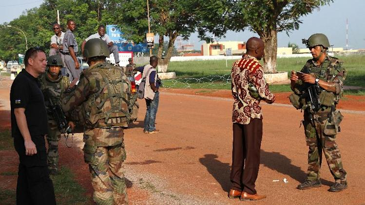 French soldiers control access to the airport in Bangui, Central African Republic, Thursday, March 28, 2013. Two months after peace negotiations led to a power sharing deal, Seleka rebel forces invaded Central African Republic's capital over the weekend. Rebel leader Michel Djotodia Sunday declared himself president of the impoverished, but mineral rich nation for at least the next three years, but some of his colleagues from the Seleka alliance are already saying they never intended for him to single handedly lead the country after the ouster of longtime President Francois Bozize. (AP Photo)