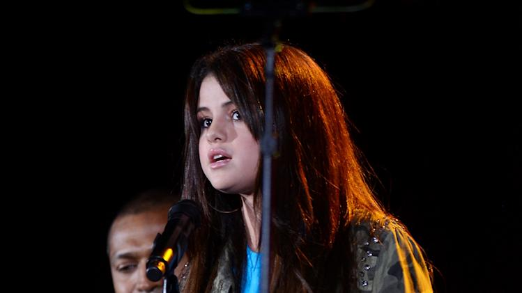 Actress Selena Gomez speaks at the Global Citizen Festival in Central Park on Saturday Sept. 29, 2012 in New York. (Photo by Evan Agostini/Invision/AP)