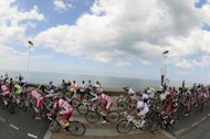 Fans cheer on the pack riding along Dieppe coast during the 214.5 km and fourth stage of the 2012 Tour de France cycling race starting in Abbeville and finishing in Rouen, northwestern France. Germany&#39;s Andre Greipel roared with raw emotion after landing his first Tour de France victory this year in a finale devoid of British sprint king Mark Cavendish